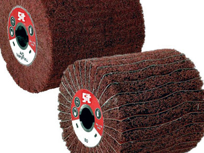 Rollers in abrasive sponge for flex brushing machines